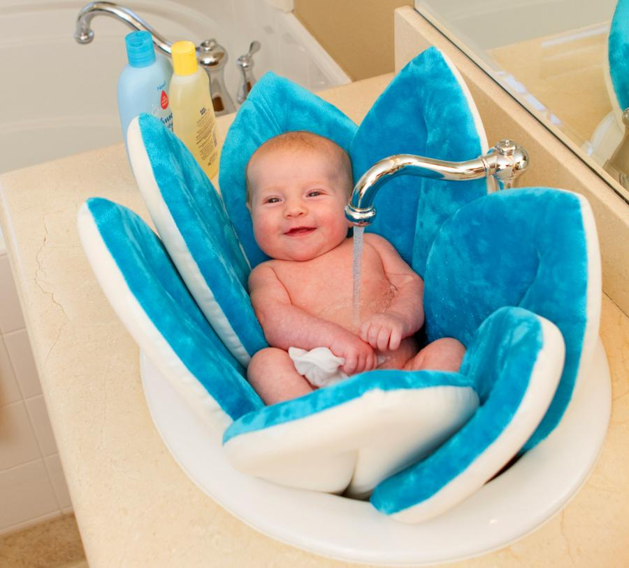 Blooming bath a flower shaped baby support for sink baths for Where can i buy a bathtub