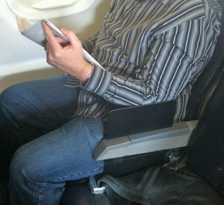 Create-a-Space Divides The Planes Armrest So Two Can Use It