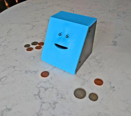 Face Bank: A Creepy Chewing Coin Bank That Eats Your Coins