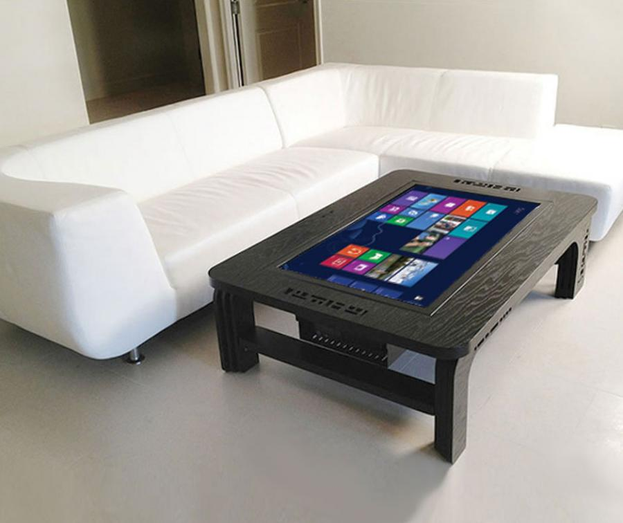 Delicieux The Touchscreen Coffee Table Computer Is Basically A Giant Tablet That Sits  Right In The Middle Of Your Coffee Table That Incorporates A Fully  Functional ...