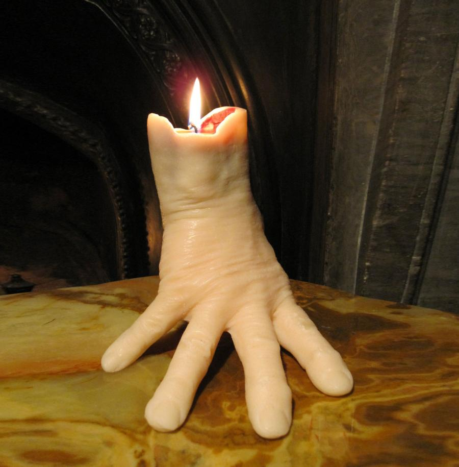 Hand Candle Bleeds As It Burns