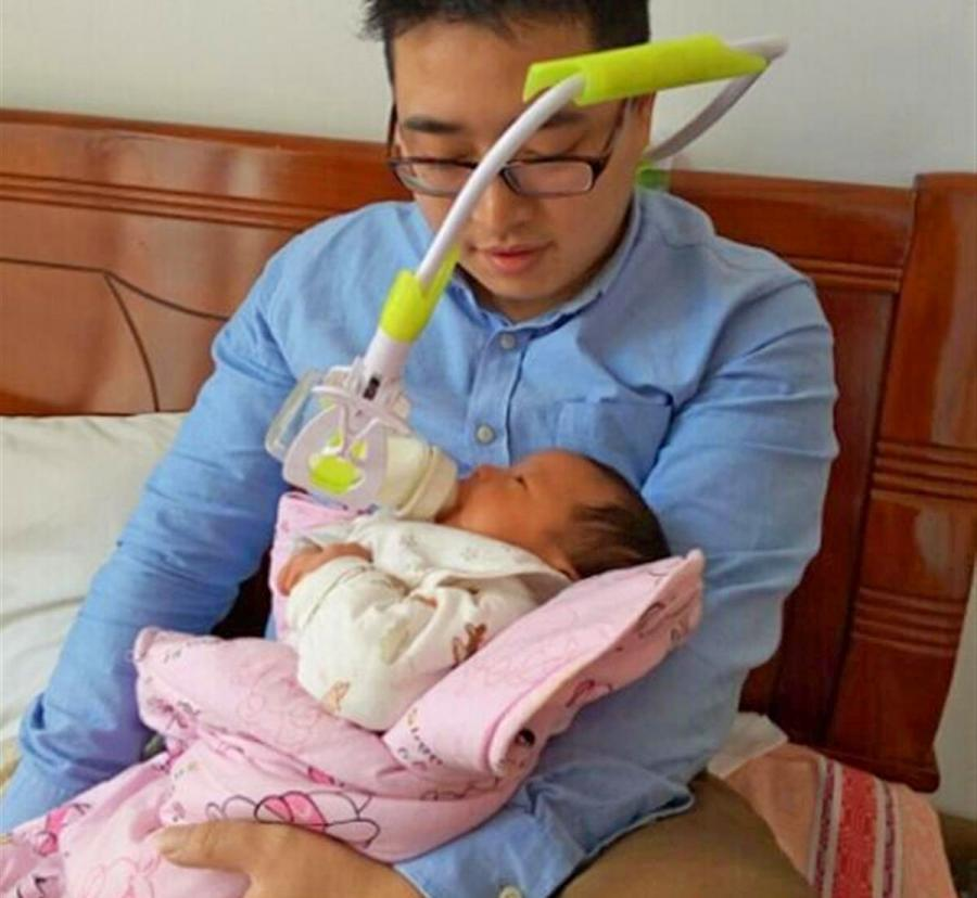 This Hands Free Baby Bottle Holder Makes Parenting Life