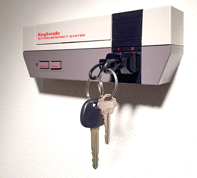 The Keytendo EnterHangment System is a key holder that looks just like the  front of an old NES console. The device comes with two key-chains that plug  right ...