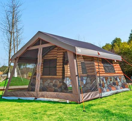 This Log Cabin Tent Has a Giant Screened In Front Porch For a True Luxury Camping Experience