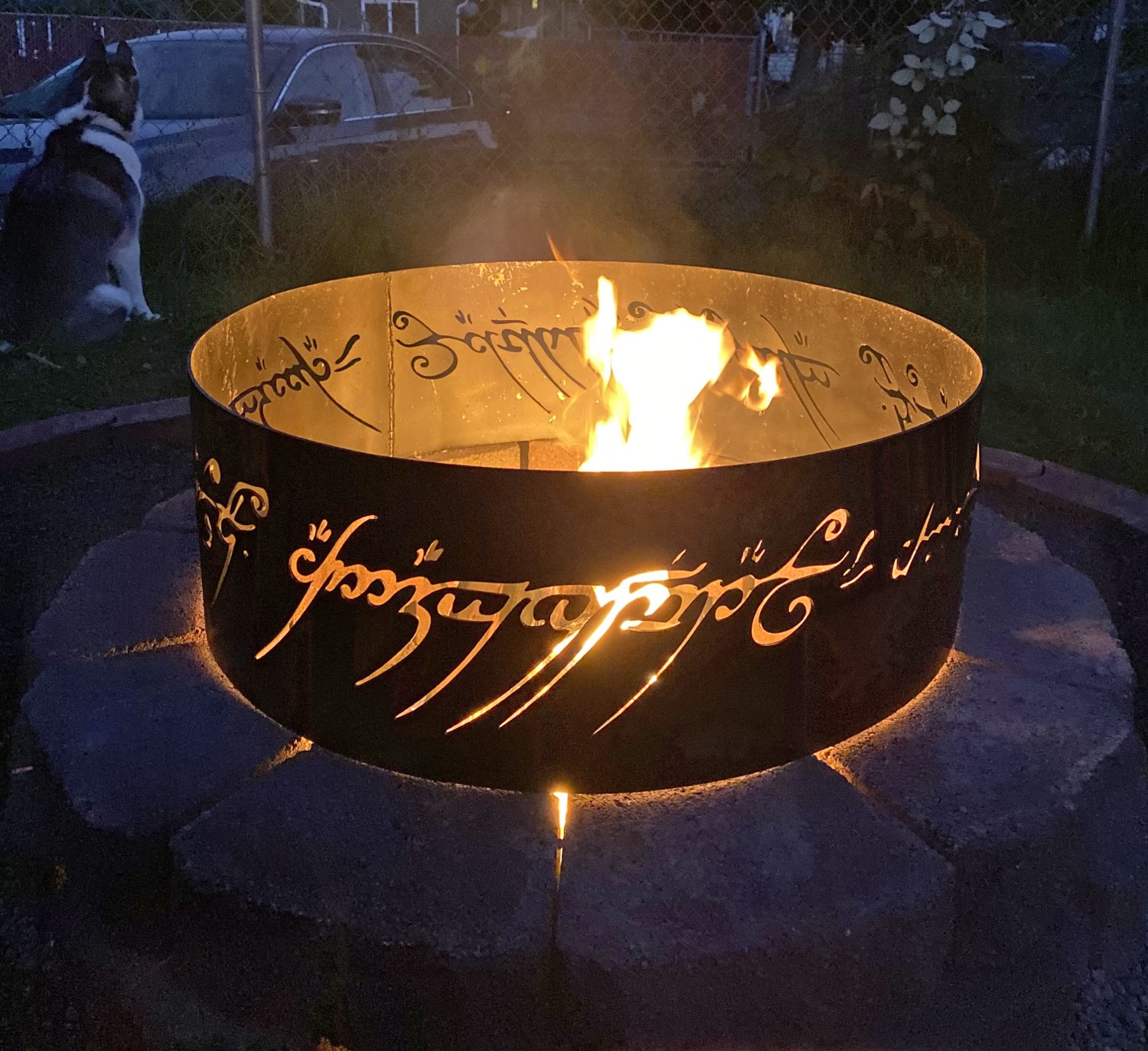 This fire pit is made to look like the One Ring from Lord Of The Rings in  that it has inscribed text on the side of the panel that is only readable  ... - Lord Of The Rings Fire Pit