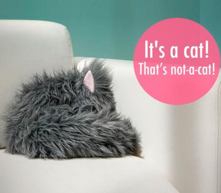 Not-A-Cat: A Stuffed Toy That Looks Like A Sleeping Cat