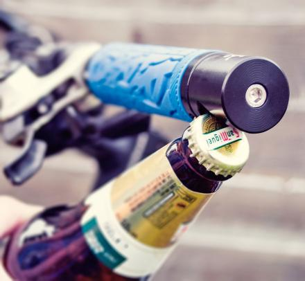 A Bottle Opener That Attaches To Your Bike's Handlebars