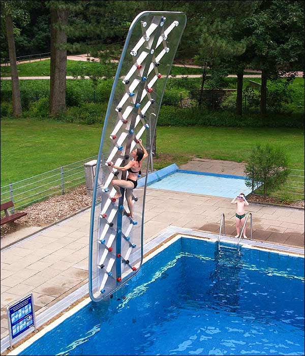 rock climbing wall in the pool. Black Bedroom Furniture Sets. Home Design Ideas