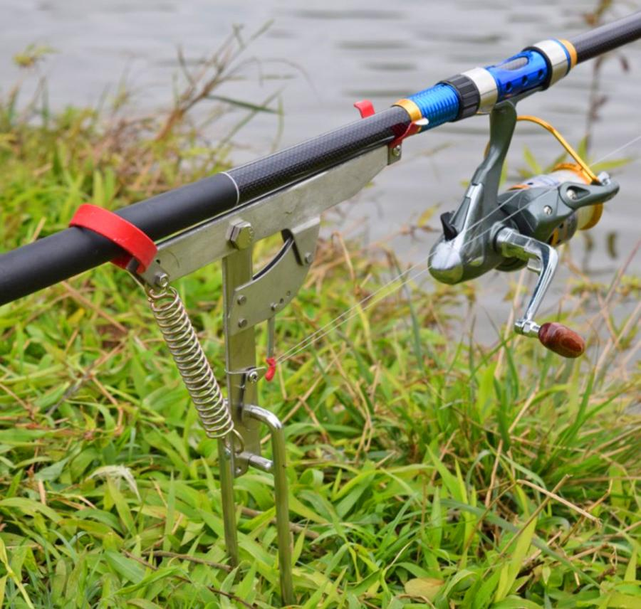 Spring fishing rod holder automatically pulls back when for Fish bite rod holders