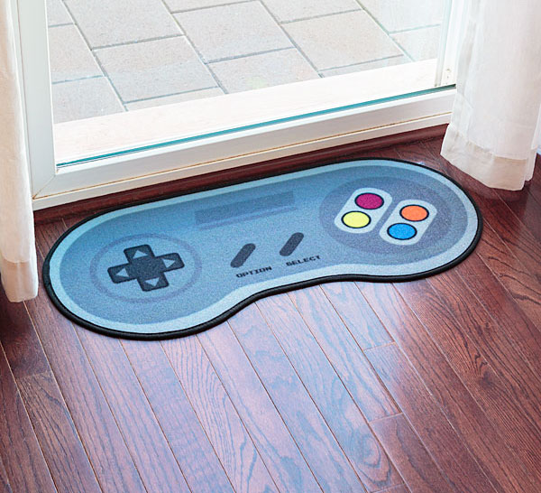 The 16 bit game controller door mat is a rug that looks just like the  controller for a Super Nintendo. Perfect for keeping the Cheetos crumbs off  the floor ...