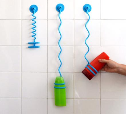 The Bungee Bath Is A Bungee Cord That Holds Your Shower Bottles