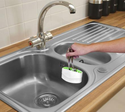 The Cutlery Cleaner Attaches To Your Sink To Easily Clean Your Silverware