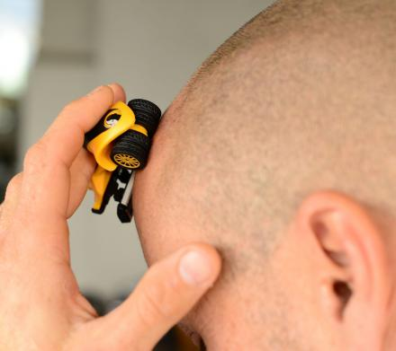 The HeadBlade Is a Toy Car Head Shaver