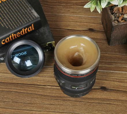 This Camera Lens Coffee Mug Stirs Itself
