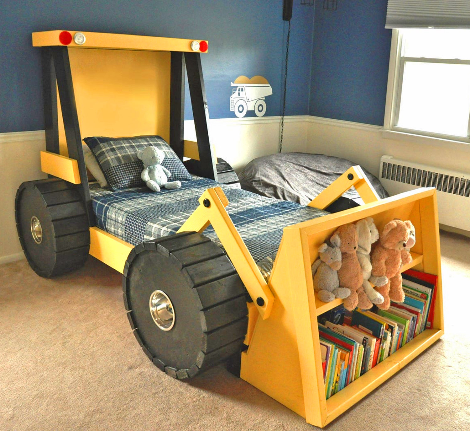 Picture of: This Construction Truck Kids Bed Has A Built In Bookshelf In The Bucket