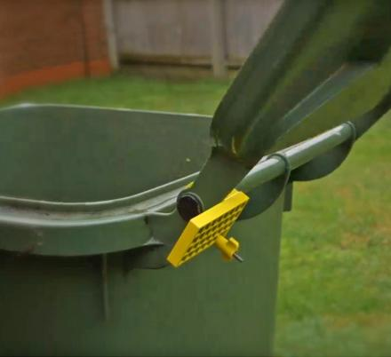This Genius Garbage Can Lid Assist Stops The Trash Lid From Slamming Backwards