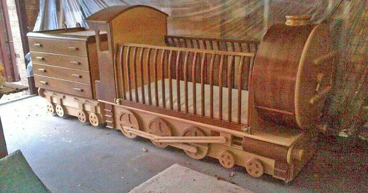 This Handmade Wooden Train Crib Pulls Behind a Dresser Train Car