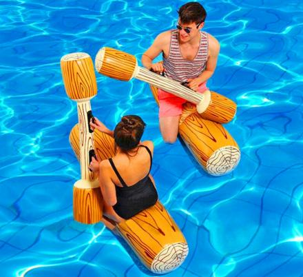 This Inflatable Log Gladiator Game Lets You Battle Your Friends In The Pool