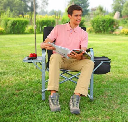 This Folding Lawn Chair Has a Cooler and a Side-Table Attached To It