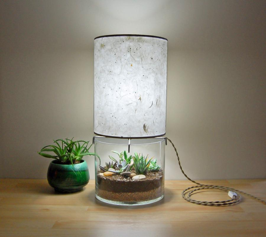 This Paper Lampshade Table Lamp Has A Glass Base For A