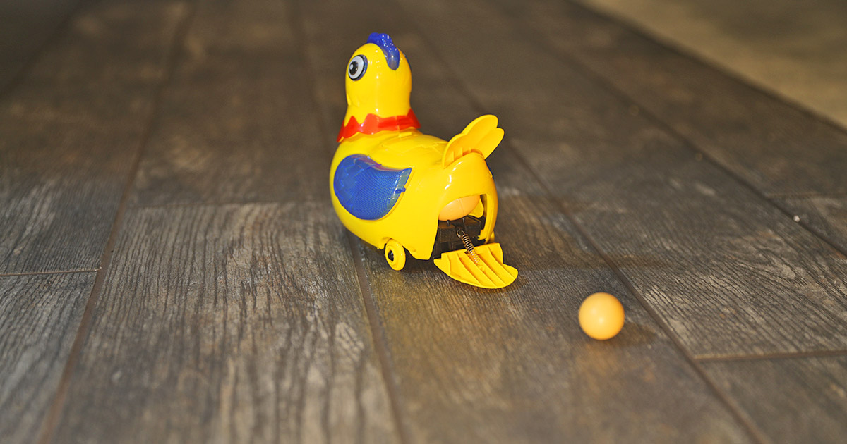 This Robotic Chicken Toy Dances Around And Randomly Lays Egg Around Your Home