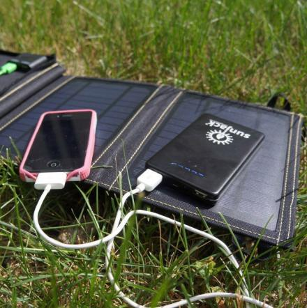 folding solar charger for charging devices on the go. Black Bedroom Furniture Sets. Home Design Ideas