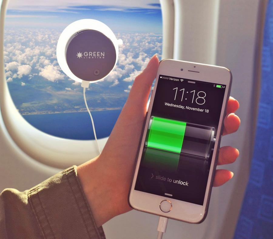 This Solar Phone Charger Attaches To Any Window Charges