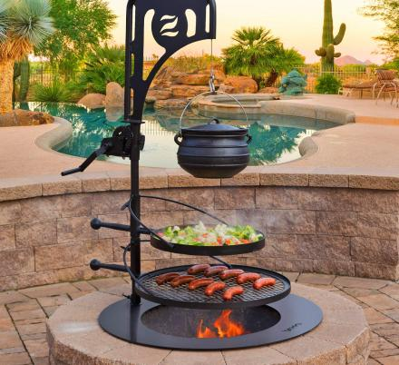 This Ultimate Campfire Grill Turns Your Fire Pit Into a Tiered Cooking Machine With a Winch