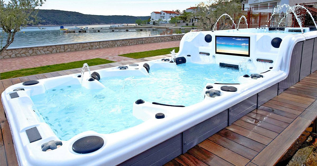 This Ultimate Hot Tub Has Two Levels To It, Seats 12, and Has a Built-in TV Screen