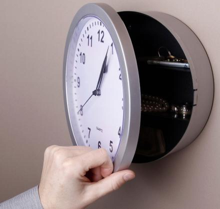 This Wall Clock Swings Open To Reveal a Secret Hidden Safe Inside