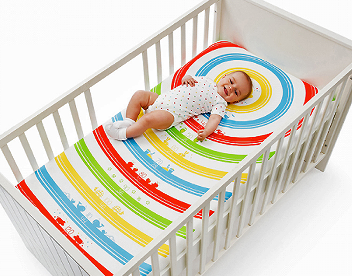 baby measuring bed sheets