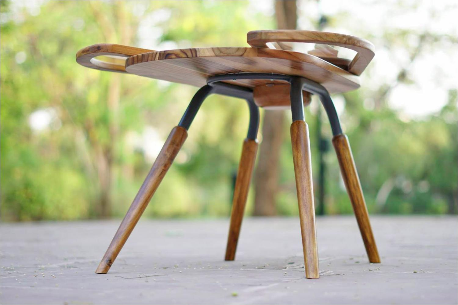 Beetle Inspired Coffee Table Has Wings That Spread Out To Increase Surface Area - Elytra extending coffee table