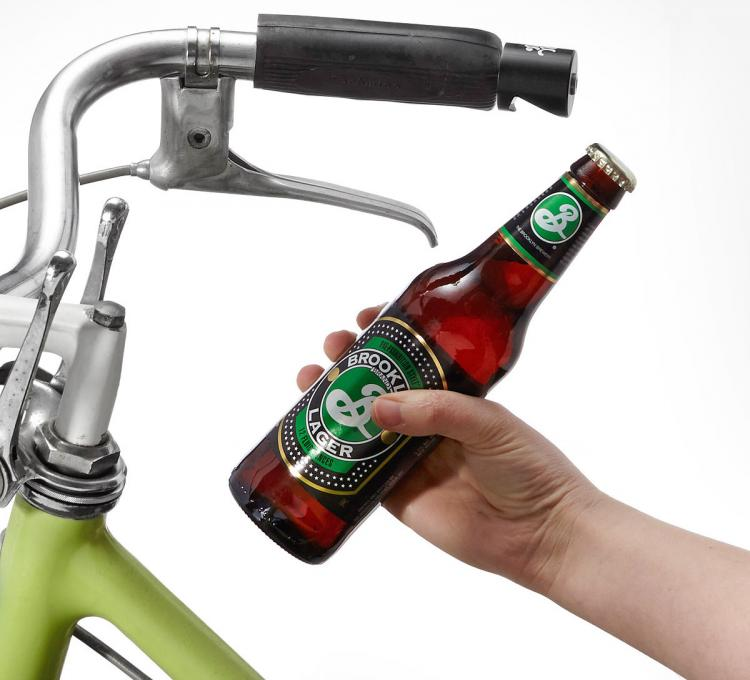 a bottle opener that attaches to your bike 39 s handlebars. Black Bedroom Furniture Sets. Home Design Ideas