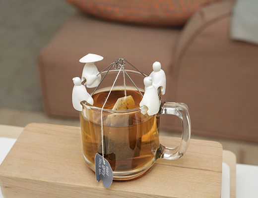 These Chinese Fisherman Sit On Your Cup And Hold Your Tea