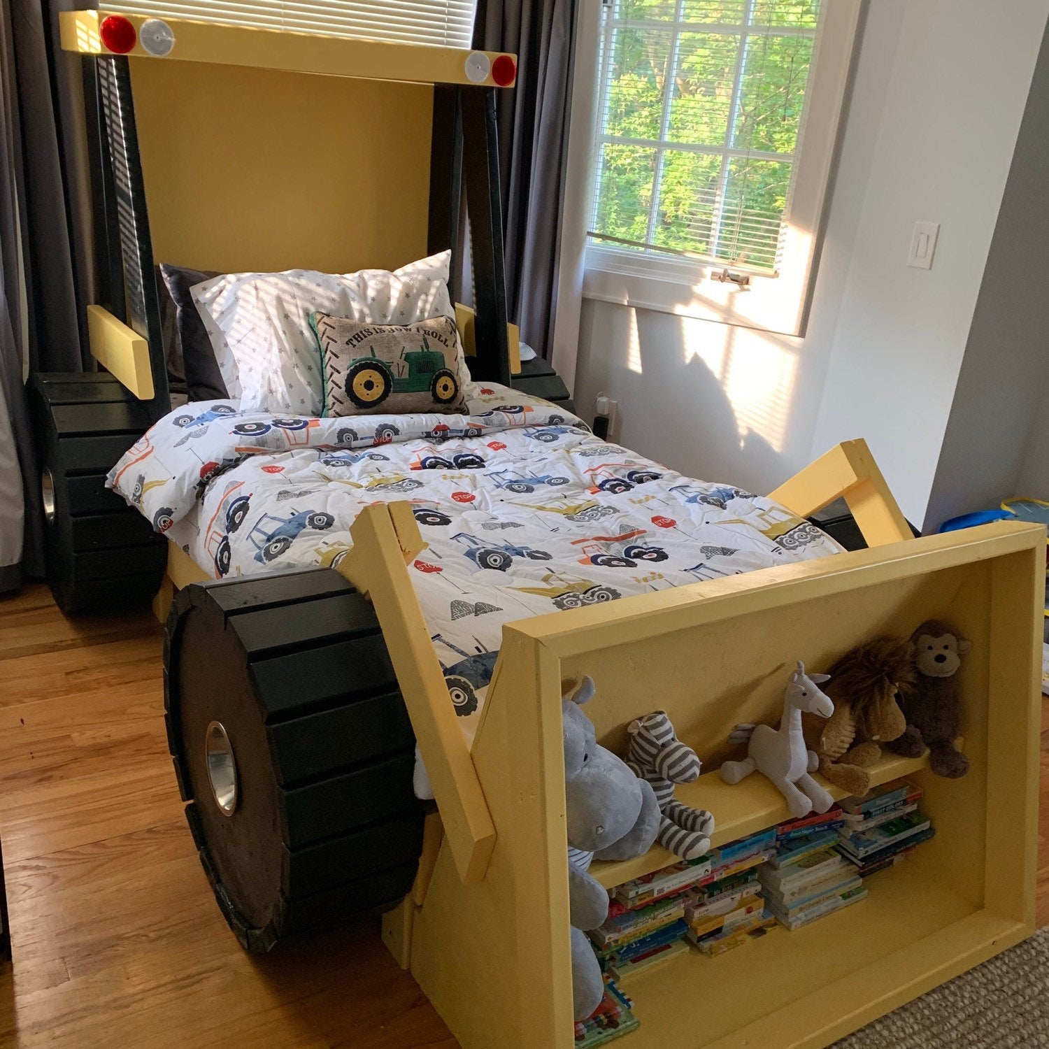 This Construction Truck Kids Bed Has A Built In Bookshelf In The Bucket