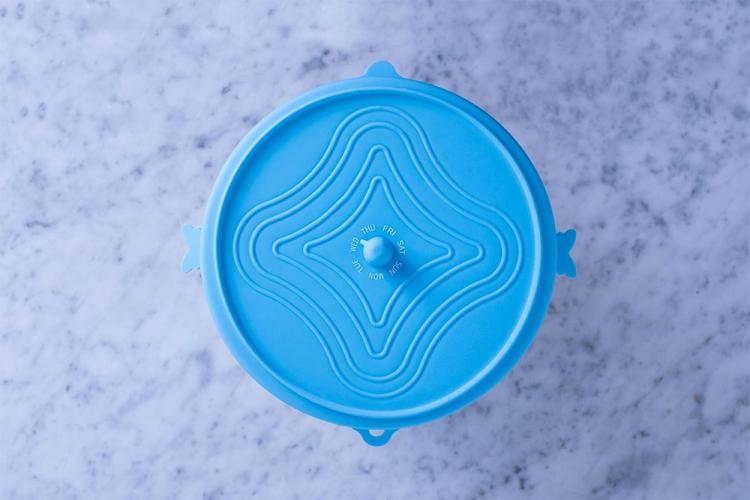 Unilid Stretchy Silicone Universal Leftover Lid - Leftover lid with day of week dial to track how old leftovers are