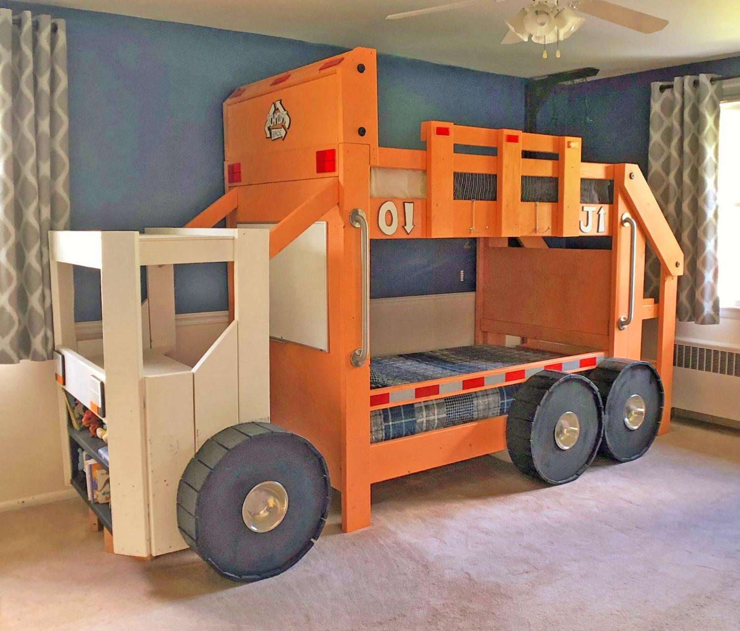 Picture of: This Garbage Truck Bunk Bed Has A Desk And Bookshelf In The Cabin Of The Truck