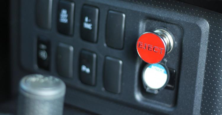 Fake eject button for car cigarette lighter