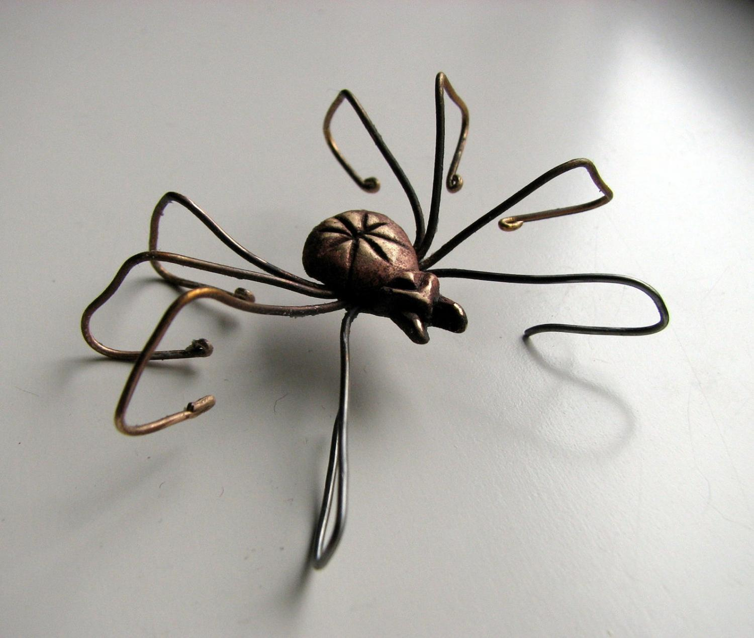 Giant Spider Earrings - Dangling spider earrings with spider leg through ear hole