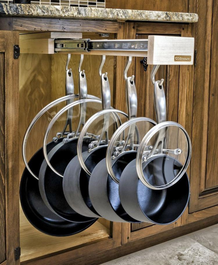 Slide-out pot holder cabinet