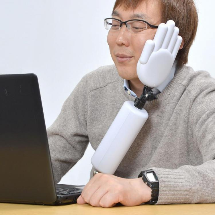 Japanese Creepy Hand Shaped Head Holder - naps at work