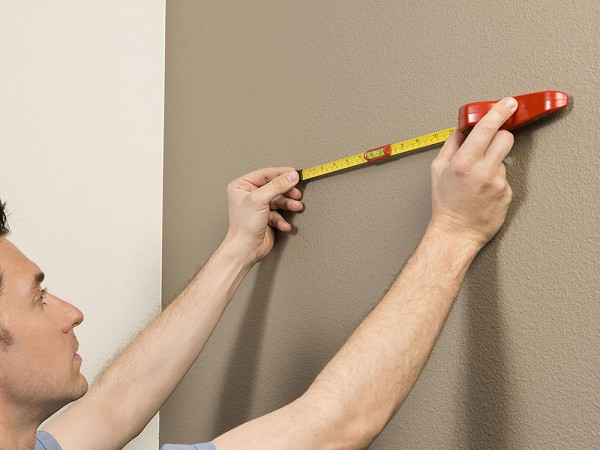 Hang-o-matic: All-in-one Picture Hanging Tool - Picture hanging tools built into tape measure
