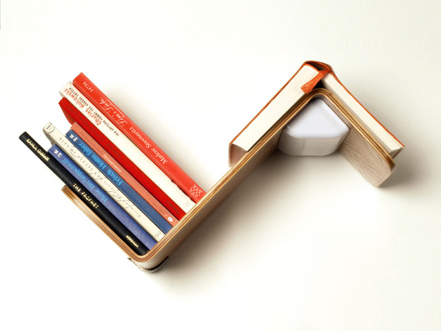 Lililite A Bookshelf Lamp Acts As A Bookmark And Turns