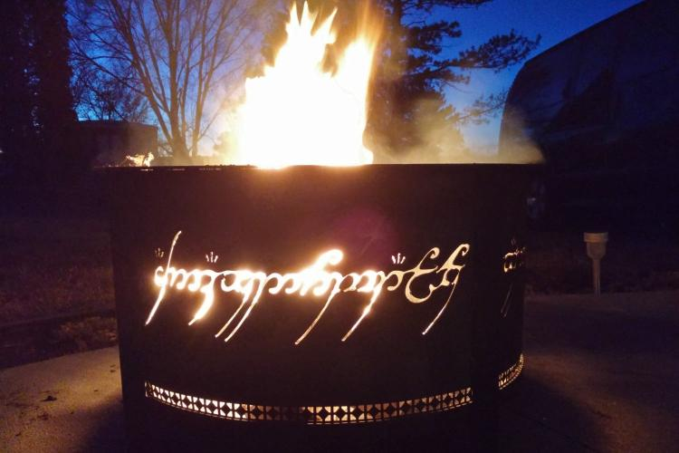 also be sure to check out this other lord of the rings fire pit that has the same concept with the black speech text inscribed around the paneling