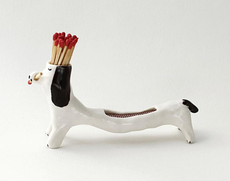 Matchstick Holding Dog - With Striker Area on Its Back