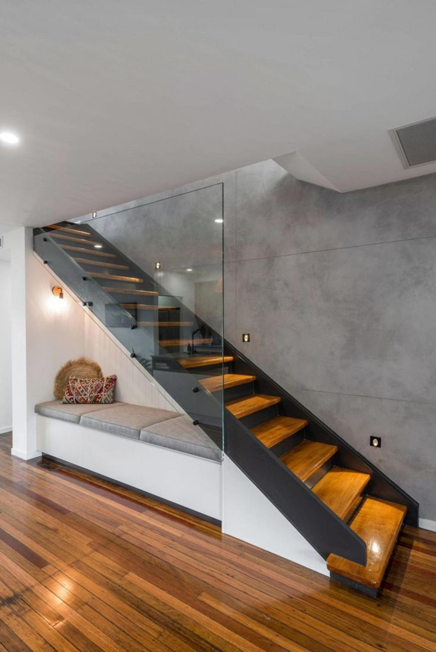 Most Creative Under The Stairs Home Designs - Modern lounge couch under the stairs