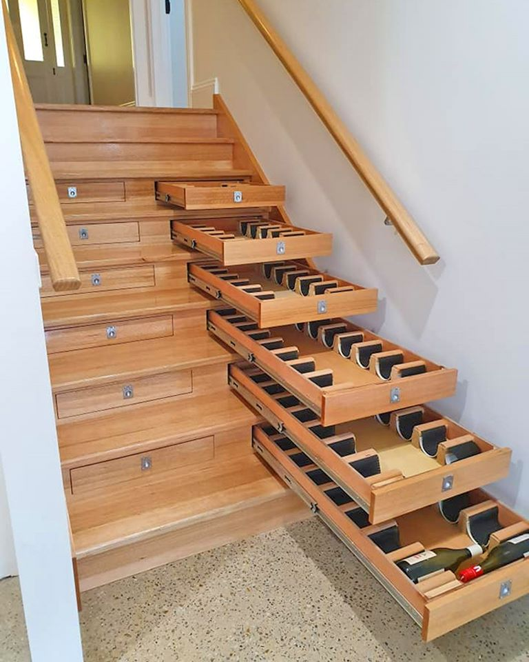 Most Creative Under The Stairs Home Designs - Hidden wine storage drawers inside stairs