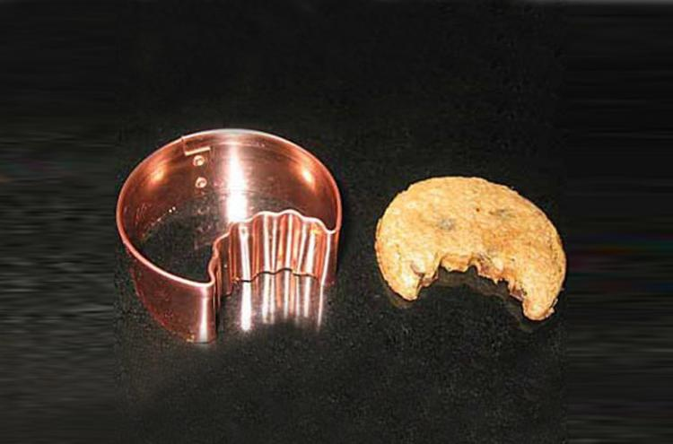 Once bitten cookie cutter - Cookie cutter makes cookies with a bite already taken out of cookie