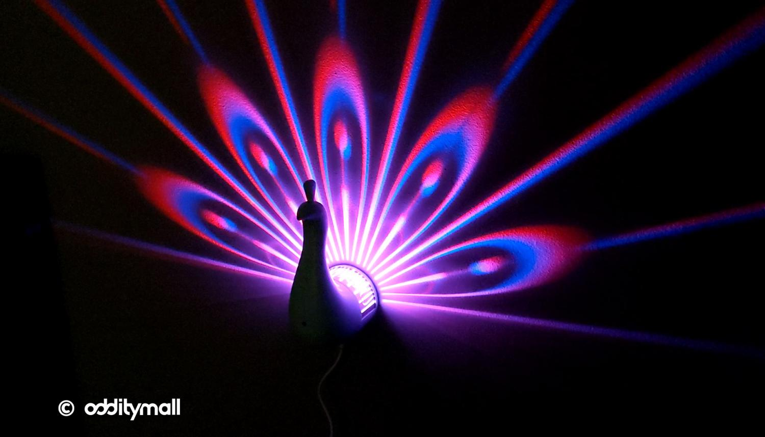 LED Peacock Night-Light Projects Its Colorful Plumage Onto Your Wall