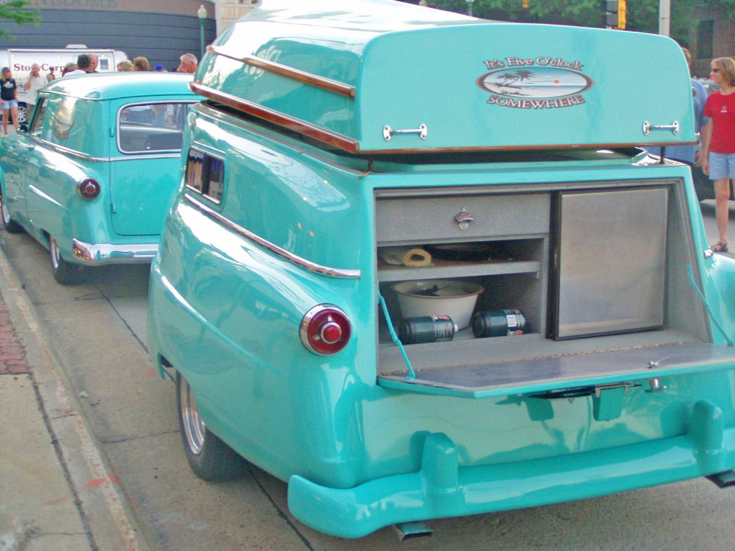 Retro Camper Boat - 1950's Teardrop trailer with row boat as roof of camper